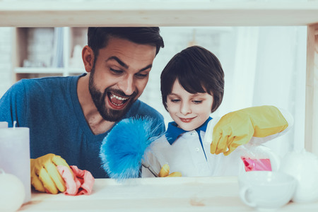 Spends Time. Smile. Cleanliness. Family. Have Fun. Clean House Together. Holidays.Two Boys. Father. Baby with Bright Hair. Smiling Kids. Happy Together. Home Time. Father Two Boys. Leisure Time. Man.