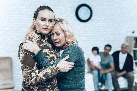 A Woman In Camouflage Goes To Military Service.
