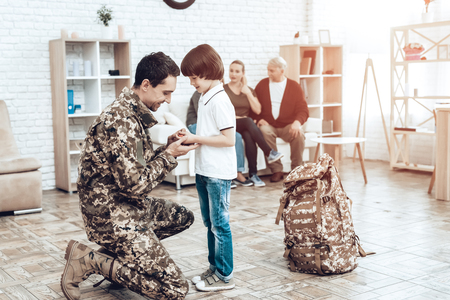 A Man Goes To Military Service. Saying Goodbye. Imagens