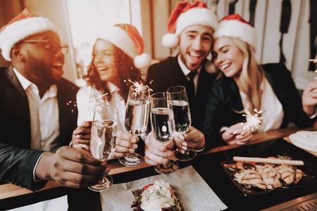 Santas Hat. Nightlife. Young People. Rest. Bar. Girls and Guys. Drink Alcoholic Beverages. Different Races Communicate. Have Fun. Together. Clubbing. Joyful. Chin-chin. Leisure. Positive. Emotion.