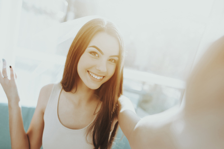 Smiling Girl Is Doing A Selfie Before Hen-party. Pre-wedding Care Concept. Beautiful Shiny Smile. Camera Staring. Sunny Day. Good Mood. Young And Attractive. Happy Holiday. Long Hair.