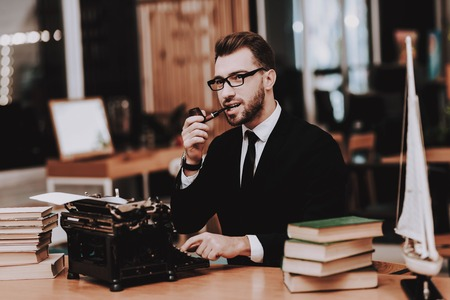 Eyeglasses. Businessman. Suit. Old Typewriter. Hands. Young Male. Working in Office. Creative Worker. Creates Ideas. Desk. Workplace. Project. Sit. Brainstorm. Work. Office. Inspiration. Reklamní fotografie