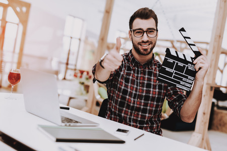 Laptop. Movie Clapper. Ideas. Light Bulb. Glasses. Comfortable. Project. Sit. Brainstorm. Young Guy. Businessman. Work. Office. Creative Worker. Businesspeople. Workplace. Inspiration. Stockfoto