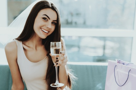 Smiling Girl Is Prepairing To Hen-party. Wine Drinking. Pre-wedding Care. Beautiful Smile. Glass Of Champagne. Sunny Day. Good Mood. Young And Attractive. Happy Holiday. Long Hair. Stok Fotoğraf