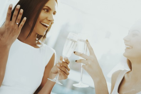 Girls Are Drinking Champagne Before Hen-Party. Pre-wedding Concept. Beautiful Shiny Smile. Resting With Bride. Sunny Day. Good Mood. Young And Attractive. Happy Holiday. Long Hair.
