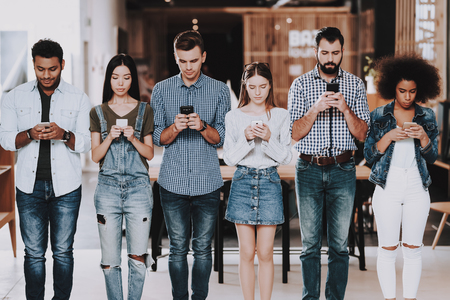 Young People. Stand in Line. Mobile Phones. Busy. Not Pay Attention. Own Affairs. Young Specialists. Look. Teamwork. Discussion. Brainstorm. Design Studio. Multi-Ethnic. Project. Creative. Workplace.