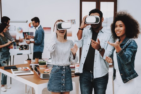 Design Studio. Virtual Reality Glasses. Look. Designers. Young Specialists. Choose Colors for Design. Teamwork. Discussion. Brainstorming. Multi-Ethnic. Project. Creative. Workplace.