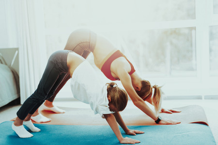 Mum And Daughter Are Doing Athletics At Home. Yoga Concept. Beauty And Grace. Active Lifestyle. Relaxing Together. Doing Fitness. Holiday Leisure. Body Balance. Sport Exercise. Gym Carpet.