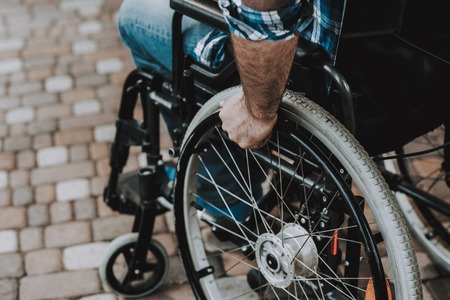 Close up. Disabled Man on Wheelchairs in Park. Disabled Young Man. Relaxing in Summer Park. Fun in Summer Park. Recovery and Healthcare Concepts. Man in Checkered Shirt. Sitting Man. Stok Fotoğraf