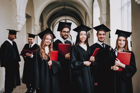 Architecture. Diploma. University. Students. Group of Students. Mantles. Standing. Corridor. University. Young People. Sit. Freelance. Knowledge. Study Together. Good Mood. Have Fun. Friendship.