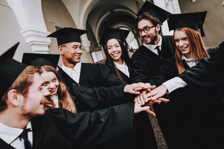 Best Friends. Architecture. Group of Students. Mantles. Standing. Corridor. University. Young People. Freelance. Knowledge.University. Students. Study Together. Good Mood. Have Fun. Friendship.