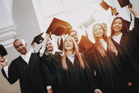 Cap. Best Friends. Finish Studies. Architecture. University. Group of Young People. Graduate. Students. Study Together. Good Mood. Have Fun. Friendship. Campus. Happiness. Knowledge. Stock Photo