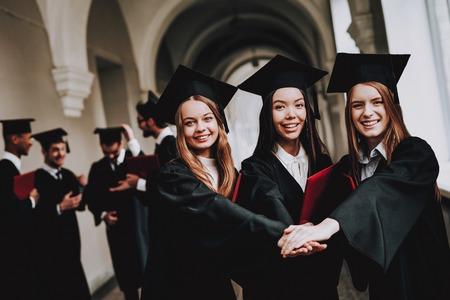 Asian Girl. Intelligence. Cap. Diploma. Cheerful. Celebration. Architecture.Happiness. Standing. Corridor. University. Robes. Graduate. Happy. Good Mood. University. Campus. Knowledge. Mortar Board.