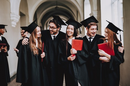 Study Together. Good Mood. Have Fun. Friendship. Group of Students. Mantles. Standing. Corridor. University. Young People. Sit. Freelance. Knowledge. Architecture. University. Students. Diploma. Stock Photo
