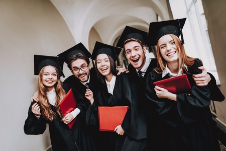 Diploma. University. Students. Mantles. Friendship. Group of Students. Standing. Corridor. University. Young People. Freelance. Knowledge. Architecture. Study Together. Good Mood. Have Fun.