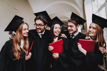 Have Fun. Friendship. Diploma. Group of Students. Mantles. Standing. Corridor. University. Young People. Sit. Freelance. Knowledge. Architecture. University. Students. Study Together. Good Mood.