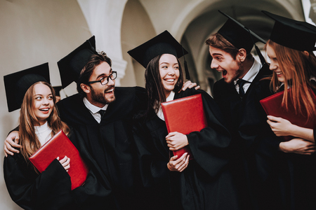 Group of Students. Diploma. Mantles. Standing. Corridor. University. Young People. Sit. Freelance. Knowledge. Architecture. University. Students. Study Together. Good Mood. Have Fun. Friendship. Stock Photo