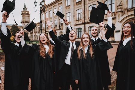Caps Up. Graduate. Architecture. Finish Studies. Group of Young People. University. Students. Study Together. Friendship. Cap. Campus. Happiness. Knowledge. Good Mood. Have Fun. Best Friends.