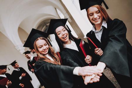 Celebration. Girls. Cap. Architecture. University. Campus. Cheerful. Happiness. Intelligence. Diploma. Standing. Corridor. University. Robes. Graduate. Happy. Good Mood. Man. Knowledge. Mortar Board.