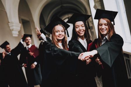 University. Campus. Girls. Cheerful. Celebration. Cap. Architecture. Happiness. Intelligence. Diploma. Standing. Corridor. University. Robes. Graduate. Happy. Good Mood. Man. Knowledge. Mortar Board.
