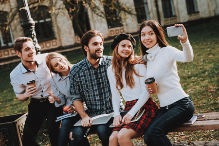 Sit. Courtyard. University. Selfie. Knowledge. Architecture. Freelance. Hipster. Group of Young People. Students. Study Together. Good Mood. Laptop. Textbooks. Have Fun. Notebooks. Friendship.