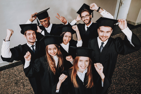 Cap. Campus. Happiness. Knowledge. Best Friends. Finish Studies. Group of Young People. Graduate. Architecture. University. Students. Study Together. Good Mood. Have Fun. Friendship.