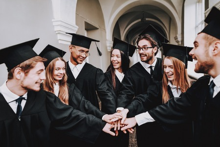 Study Together. Good Mood. Group of Students. Mantles. Standing. Corridor. University. Young People. Sit. Freelance. Knowledge. Architecture. University. Students. Have Fun. Friendship. Stock Photo