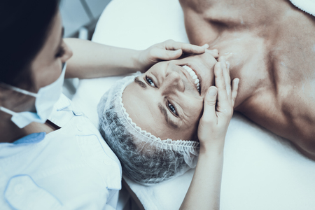 Young Man in Spa Salon for Cleansing Massage. Guy in Beauty Salon. Modern Cosmetology. Proffesional Cosmetologist. Doctor in White Coat. Mens Beauty Concept. Skin Care and Cleaning.