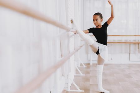 Ballet Training of Young Girl in Balerina Tutu. Stock Photo - 112540644