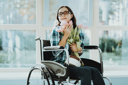 Person in Wheelchair. Woman in Wheelchair. Disabled Hall Airport. Room with Panoramic View. White Interior. Limited Opportunities. Woman Disabled. Loving Disabled. People with Limited Opportunities.