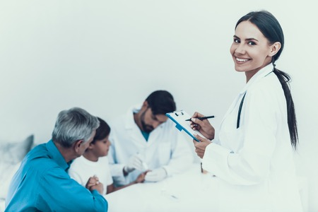 Doctor Taking Blood Sample from Boys Finger. Diabetes Concept. Sugar in Blood. Healthcare Concept. Young Man in Uniform. White Coat. Medical Equipment. Boy Visiting Clinic with Grandfather. Zdjęcie Seryjne