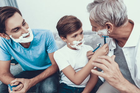 Grandfather, Father and Son Shaving Together. Spending Time Together. Father and Son. Smiling People. Parenthood Concept. Family at Home. Shaving Men. Healthcare and Hygiene Concept.