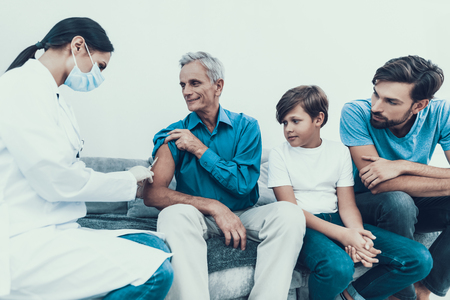Doctor Visiting Family for Injecting Insulin. Diabetes Concept. Sugar in Blood. Healthcare Concept. Young Woman in Uniform. White Coat. Medical Equipment. Glucometer in Hand. Medical Mask.