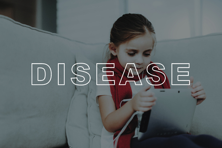 Little Sick Girl With A Digital Tablet On A Couch. Stock Photo - 112900486