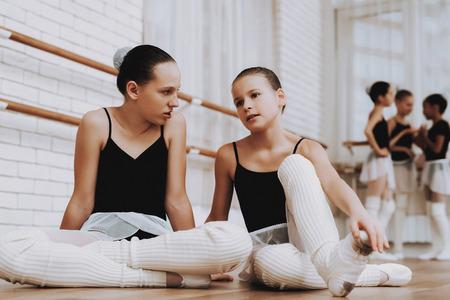Girls Resting after Ballet Training on Floor. Zdjęcie Seryjne