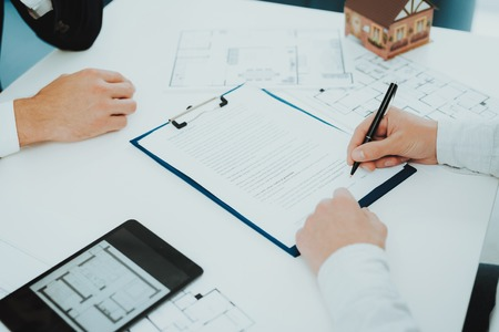 Close-up. Contract Signing Concept. Property Buy. Bright Office. Business Meeting. Customer And Buyer. Offer Discussion. Professional Agreement. House Selling Proposal. Document Signature. 스톡 콘텐츠