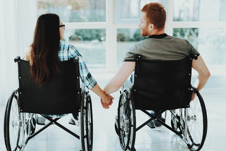 People in Wheelchair. Airport Hall. Woman in Wheelchair. Room with Panoramic View. Limited Opportunities. Woman Disabled. Romantic Meeting Disabled. Loving Disabled. People with Limited Opportunities. Stok Fotoğraf