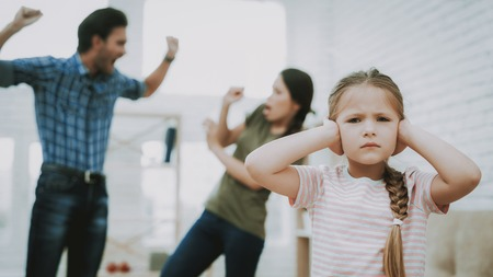 Child Closes Ears. Child and Quarreling Parents. Family Problems. Parents Scandal. Aggressive Father. Angry Person. Complicated Relationship. Family Quarrel. Sufferings Children. Unhappy Child. Stock Photo - 110353123