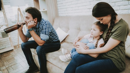 Family Problems. Parents Scandal. Scared Child. Angry Father. Upset Mom and Child. Complicated Relationship. Family Quarrel. Bad Parents. Sufferings Children. Woman Arguing with Man. Alcohol in Family Stock Photo - 110353164