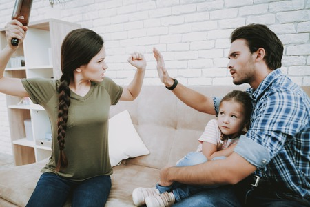 Family Problems. Parents Scandal. Scared Child. Angry Mothar. Woman Screams Man. Complicated Relationship. Family Quarrel. Bad Parents. Sufferings Children. Woman Arguing with Man. Alcohol in Family. Stock Photo - 110350897