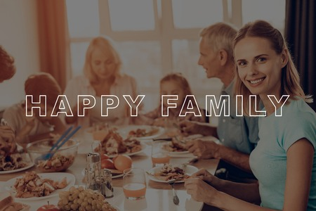 Celebrating Holiday. Have Fan. Holiday. Family. Smartphone. Traditional Dinner. Cups of Tea. Baked Turkey. Happy Family. Thanksgiving Day. Together at Home. Autumn Feast. Delicious Food.