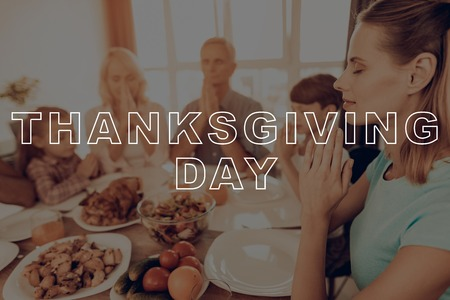 Celebrating Holiday. Pray. Joined Hands. Eyes Closed. Dinner Table. Thanksgiving Day. Juice. Turkey. Salad. Traditional. Woman. Happy Family. Holiday. Have Fan. Together at Home. Delicious Food. Imagens