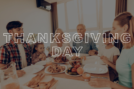 Thanksgiving Day. Pray. Joined Hands. Eyes Closed. Dinner Table. Celebrating Holiday. Juice. Turkey. Salad. Traditional. Woman. Happy Family. Holiday. Have Fan. Together at Home. Delicious Food. Stok Fotoğraf