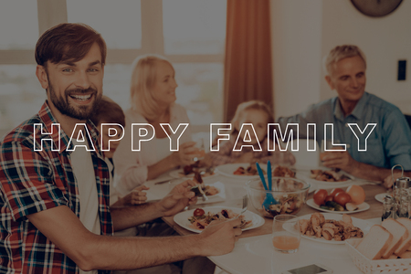 Man in Red Shirt. Salad on Plates. Cheerful. Holiday. Thanksgiving Day. Happy Family. Together at Home. Laughing. Congratulate. Woman. Celebrating. Smiling. Dinner Table. Have Fan. Delicious Food.