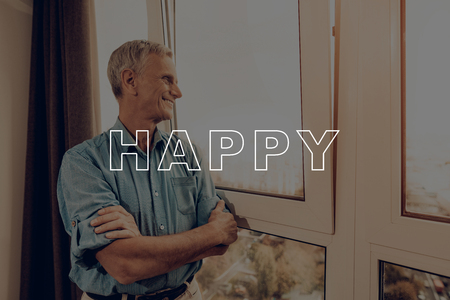 Old Man. Big Window. Smiles. He looks Blue Shirt. Family. Thanksgiving Day. Smiling. Together at Home. Have Fan. Celebrating Holiday. Kitchen. Traditional Dinner. Apartment. Autumn. Cheerful.