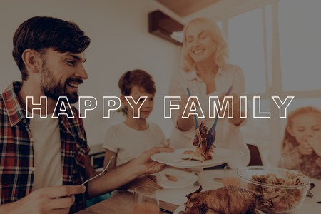 Happy Family. Salad on Plates. Delicious Food. Holiday. Middle-Aged. Cheerful. Thanksgiving Day. Together at Home. Laughing. Congratulate. Woman. Celebrating. Smiling. Dinner Table. Have Fan.