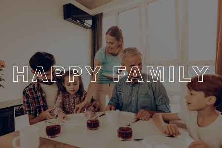 Thanksgiving Day. Cups of Tea. Big Family. Dinner Table. Woman. Plate. Blue Shirt. Holiday. Happy Family. Traditional Dinner. Have Fan. Together at Home. Autumn Feast. Celebrating Holiday. Delicious Food.