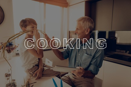 Tablet. Mustache from Green. Countertop. Sunlight. Happy Family. Dinner. Boy. Together at Home. Father. Thanksgiving Day. Have Fan. New Technology. Celebrating Holiday. Kitchen. Traditional Dinner. Imagens