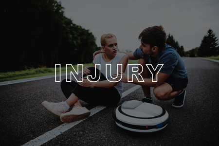 Man Approached. Injury. Fell. Hurts. Rubs. Bruised Leg. Woman. Driving. Park. Monocycle. Relaxation. Female. Road. Upset. Country Park. Gyroboard. Love Story. Park. People. Have Fun. Young People.