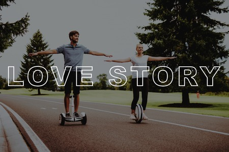 Arms Apart. Hold Hands. Smiling People. Couple. Riding. Gyroboard. Monocle. Happy. Country Park. Love Story. Happy Together. Park. Relaxation. Have Fun. Young People. Romantic Relationships. Stok Fotoğraf